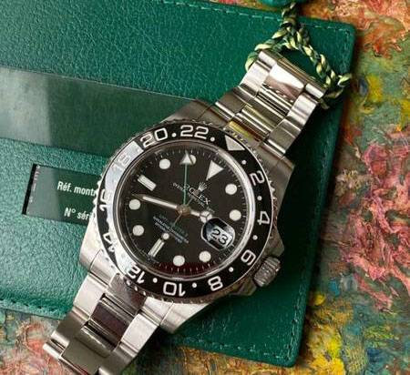 Rolex GMT Master II with box and papers - $13,500